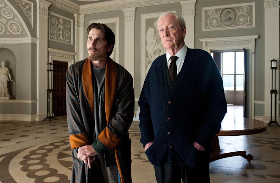 "This undated film image released by Warner Bros. Pictures shows Christian Bale as Bruce Wayne, left, and Michael Caine as Alfred in a scene from the action thriller ""The Dark Knight Rises."" (AP Photo/Warner Bros. Pictures, Ron Phillips)"