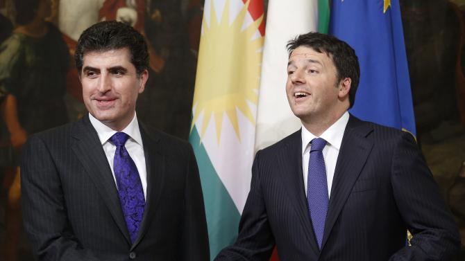 Iraq's Kurdistan Prime Minister Nechirvan Barzani (L) shakes hands with his Italian counterpart Matteo Renzi during a meeting at Chigi palace in Rome
