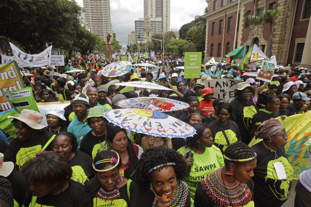 People rally to highlight climate change as the COP17 climate change conference takes place in Durban, South Africa, Saturday, Dec 3, 2011. The top U.N. climate official said Saturday she is confident that industrial countries will renew pledges to cut greenhouse gas emissions after their current commitments expire next year. (AP Photo/Schalk van Zuydam)