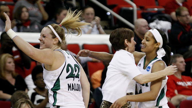 Notre Dame's Brittany Mallory (22) celebrates as coach Muffet McGraw hugs Skylar Diggins, right, following an NCAA women's college basketball tournament regional final in Raleigh, N.C., Tuesday, March 27, 2012. Notre Dame won 80-49 to advance to the Final Four. (AP Photo/Gerry Broome)