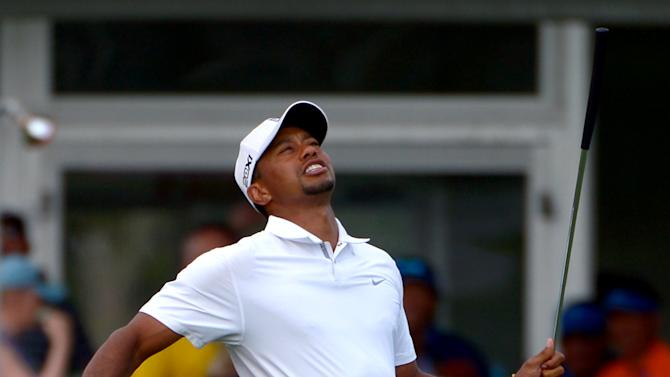 Tiger Woods reacts after missing a putt for birdie on the 17th green during the third round of the Arnold Palmer Invitational golf tournament in Orlando, Fla., Saturday, March 23, 2013. (AP Photo/Phelan M. Ebenhack)
