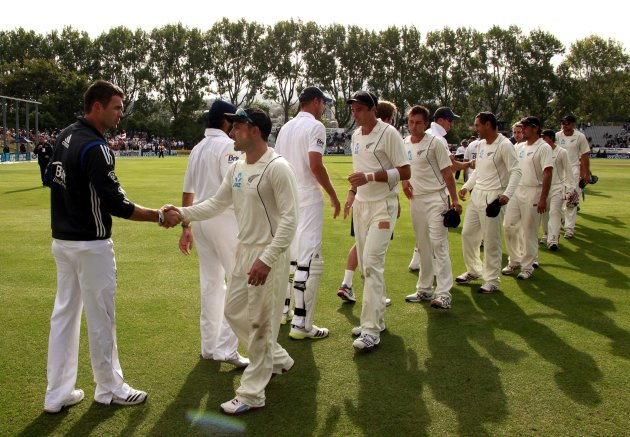 New Zealand's captain McCullum shakes hands with England's Anderson as they walk off the ground at the end of the first test at the University Oval in Dunedin