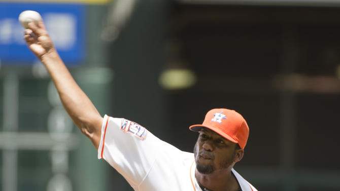Houston Astros starting pitcher Roberto Hernandez (56) throws against the Seattle Mariners in the first inning of a baseball game on Sunday, May 3, 2015, in Houston, Texas. (AP Photo/George Bridges)