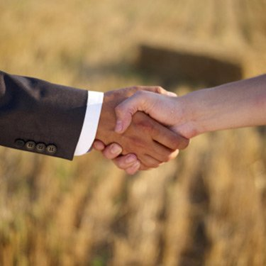 Businessman-shaking-hands-with-farmer_web