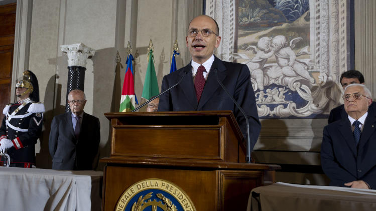 Italian Premier-designate Enrico Letta speaks during a press conference at the Quirinale Presidential Palace in Rome, Saturday, April 27, 2013. Italy has finally has a new government, a coalition of Berlusconi's forces and center-left rivals who forged an unusual alliance to break a two-month stalemate following inconclusive elections. Enrico Letta, a center-left leader, will be premier in the government, which marks the latest political comeback by Silvio Berlusconi. (AP Photo/Domenico Stinellis)