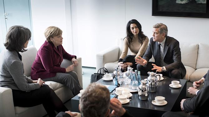 German Chancellor Merkel receives actor Clooney and his wife Amal in the Chancellery in Berlin