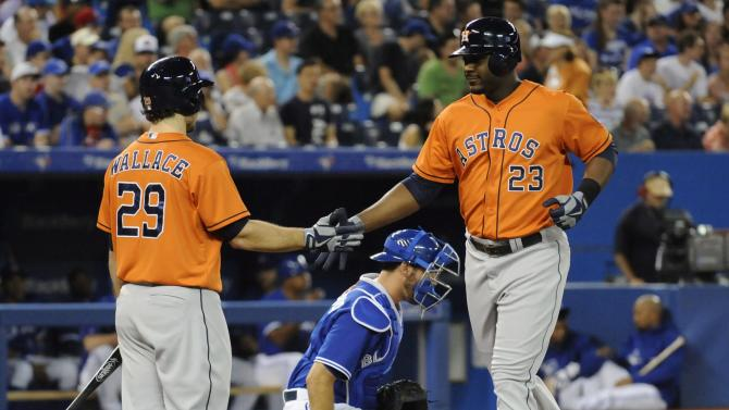 Carter hits 3-run homer as Astros beat Jays 8-6