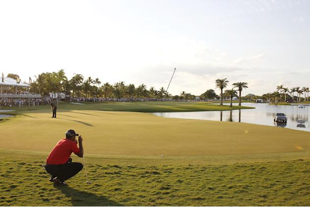 Tiger Woods looks at his last putt on the 18th green during the final round of the Cadillac Championship golf tournament Sunday, March 9, 2014, in Doral, Fla. (AP Photo/Marta Lavandier)