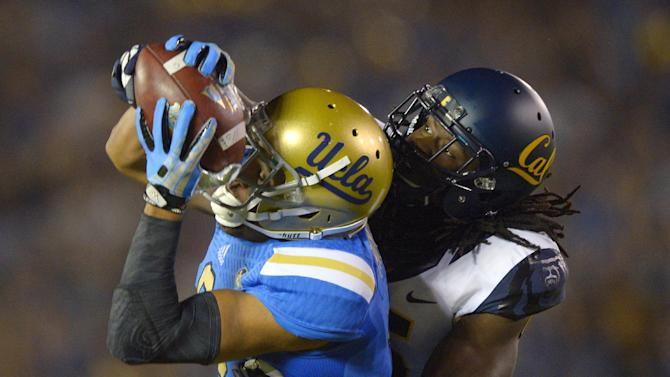 UCLA wide receiver Jordan Payton, left, makes a catch for 43 yards as California defensive back Adrian Lee tackles him during the first half of their NCAA college football game, Saturday, Oct. 12, 2013, in Pasadena, Calif. (AP Photo/Mark J. Terrill)