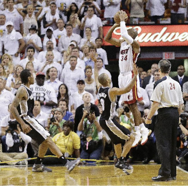 Miami Heat shooting guard Ray Allen (34) shoots a three-point basket in the end of regulation  during the second half of Game 6 of the NBA Finals basketball game against the San Antonio Spurs, Wednesd