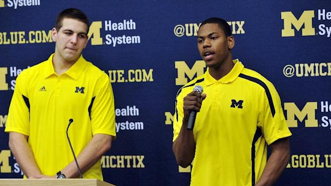 Michigan forward Mitch McGary, left, stands by as foward Glenn Robinson III speaks during an NCAA college basketball news conference, Thursday, April 18, 2013, in Ann Arbor, Mich. McGary and Robinson both announced they will forgo the NBA draft and instead return for their sophomore seasons. (AP Photo/Detroit News, John T. Greilick)  DETROIT FREE PRESS OUT; HUFFINGTON POST OUT
