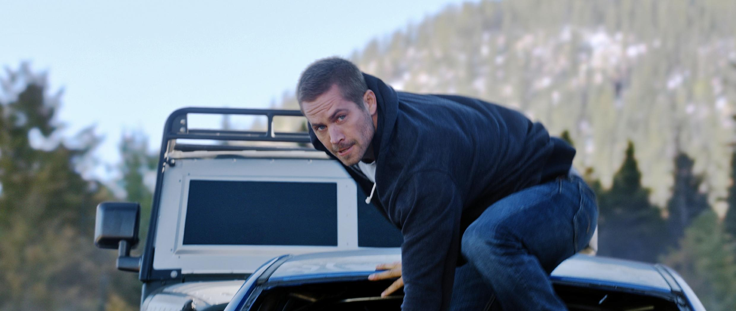 Review: 'Furious 7' drives hard with action, laughs, tribute