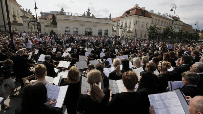 The orchestra, choir and soloists of the Chamber Opera that specializes in Mozart's music perform his Requiem, the Funeral Mass in front of the Culture Ministry in Warsaw, Poland on Tuesday, May 29, 2012 to protest recent cuts in the opera's budget and to seek government  protection. The 50-year-old opera, which  is famous for its annual festivals of all of Mozart's stage works, says it will have to close in summer if it gets no additional funds.(AP Photo/Czarek Sokolowski)