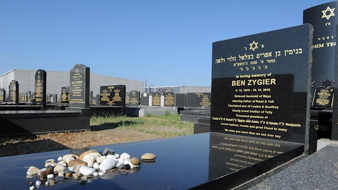 The tombstone of Ben Zygier stands at Chevra Kadisha Jewish Cemetery in Melbourne, Australia Friday, Feb 15. 2013. Foreign reports about the mysterious death of the Australian-born Israeli man who worked for Israel's Mossad spy agency and died in an Israeli prison two years ago have sparked a rare backlash against the country's well-respected security agencies. (AP Photo/Andrew Brownbill)