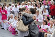 "Two women kiss in front of people taking part in a demonstration called by the ""Alliance VITA"" association against gay marriage and adoption by same-sex couples on October 23 in Marseille, southeastern France. Gay and lesbian marriage and adoption have become a flashpoint issue for the Socialist government, with a draft bill covering both rights fuelling a snowballing revolt in parliament"