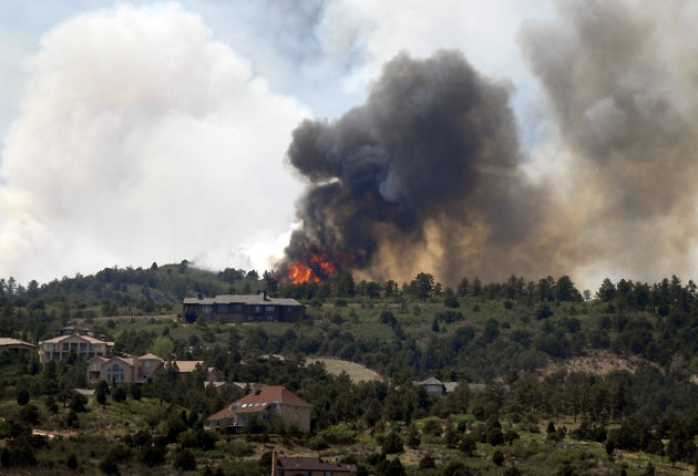 Smoke billows from a wildfire west of Colorado Springs, Colo. on Saturday, June 23, 2012. The fire has grown to an estimated 600 acres and The Gazette reports authorities are evacuating the exclusive Cedar Heights neighborhood as well as the Garden of the Gods nature center.