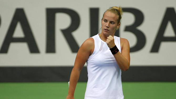 Hogenkamp of Netherlands reacts after winning a point during her FedCup World Group first round tennis match against Kuznetsova of Russia in Moscow.