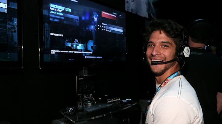 Tyler Posey is seen at the Ubisoft booth on Day 1 of E3, Tuesday, June 11th, 2013 in Los Angeles. (Photo by Alexandra Wyman/Invision for Ubisoft/AP Images)