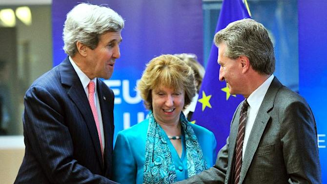 US secretary of State John Kerry (L), flanked by High Representative of the European Union Catherine Ashton, shakes hands with EU commissioner for Energy Guenther Oettinger at the headquarters of the European Union in Brussels on April 2, 2014
