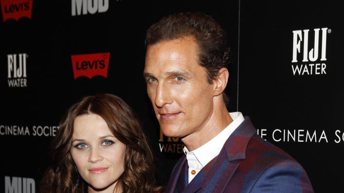"""IMAGE DISTRIBUTED FOR FIJI WATER -Actors Reese Witherspoon and Matthew McConaughey arrive for The Cinema Society's screening of """"Mud"""" presented by FIJI Water, Sunday, April 21, 2013, in New York. (Photo by Jason DeCrow/Invision for FIJI Water/AP Images)"""