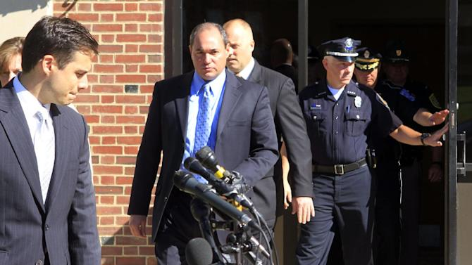 """New Hampshire Assistant Attorney General James Vara, left, is joined by law enforcement officers for a news conference in Dover, N.H. on Saturday, Oct. 13, 2012 to announce that University of New Hampshire student, Elizabeth """"Lizzi"""" Marriott who disappeared this week, is dead. (AP Photo/Jim Cole)"""