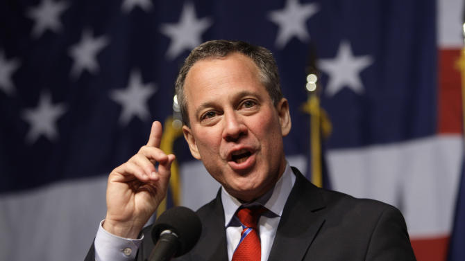 FILE - In this Nov. 3, 2010 file photo, New York Attorney General-elect Eric Schneiderman gestures while giving his victory speech just past midnight in New York. The New York attorney general's office has hit JPMorgan Chase & Co. with a civil lawsuit, alleging that investment bank Bear Stearns — prior to its collapse and subsequent sale to JPMorgan in 2008 — perpetrated massive fraud in deals involving billions in residential mortgage-backed securities. (AP Photo/Frank Franklin II, File)