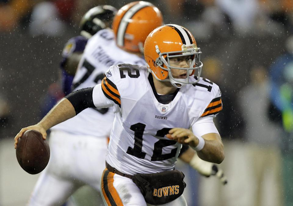 Cleveland Browns quarterback Colt McCoy (12) runs from the pocket in the third quarter of an NFL football game against the Baltimore Ravens, Sunday, Dec. 4, 2011, in Cleveland. McCoy passed for 192 yards and one touchdown in the Browns' 24-10 loss. (AP Photo/Mark Duncan)