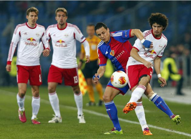 FC Basel's David Degen fights for the ball with Ramalho of FC Salzburg during their Europa League round of 16 soccer match at St.Jakob-Park stadium in Basel