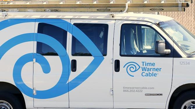 A Time Warner Cable truck sits parked at its office in Carlsbad