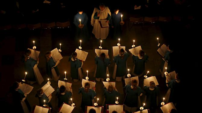 "Choristers sing as Salisbury Cathedral celebrates the beginning of Advent with a candle lit service and procession, ""From Darkness to Light"", in Salisbury"