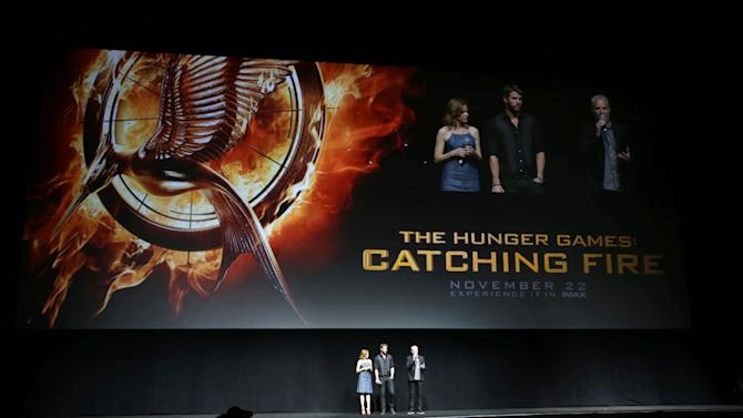"""Elizabeth Banks and Liam Hemsworth, cast members in the upcoming film """"The Hunger Games: Catching Fire""""  and Francis Lawrence, director of the upcoming film """"the Hunger Games: Catching Fire"""" at Lionsgate Presentation at 2013 CinemaCon, on Thursday, April, 18th, 2013 in Las Vegas. (Photo by Eric Charbonneau/Invision for Lionsgate/AP Images)"""