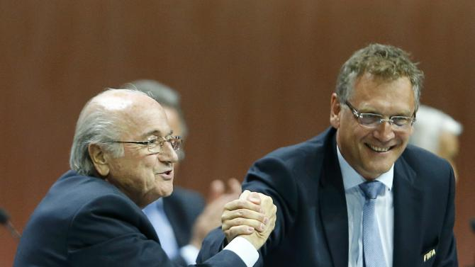 FIFA President Blatter and Valcke, Secretary General of the FIFA do a Handshake For Peace at the 65th FIFA Congress in Zurich