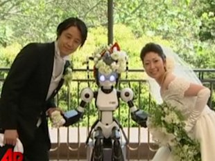 Nothing says true love like a robotic officient named I-Fairy. (AP)