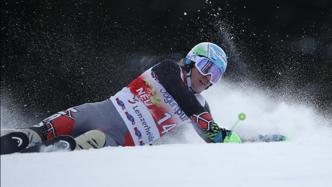 Ted Ligety,of the US, crashes during the men's slalom for the finals of the Alpine skiing World Cup in Lenzerheide, Switzerland, Sunday,March.17,2013.(AP Photo/Shinichiro Tanaka)
