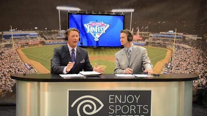 COMMERCIAL IMAGE - KC Metro Sports reporters Leif Lisec (from left) and Brad Porter broadcast from the Time Warner Cable booth at MLB Fan Fest on Friday, July 6, 2012 in Kansas City, MO.  (Photo by G.Newman Lowrance/Invision for TWC/AP Images)