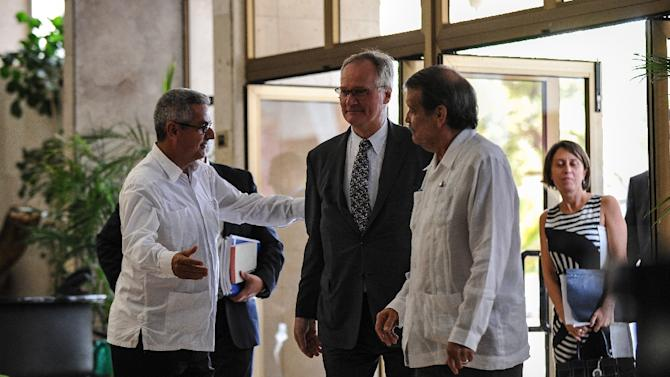 European chief negotiator Christian Leffler (C) and Cuban Deputy Foreign Minister Abelardo Moreno (R) are seen before a meeting in Havana on March 4, 2015