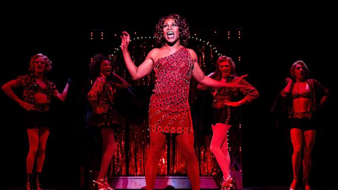 """This theater image released by The O+M Company shows Billy Porter during a performance of """"Kinky Boots."""" The Cyndi Lauper-scored """"Kinky Boots,"""" based on the 2005 British movie about a real-life shoe factory that struggles until it finds new life in fetish footwear, is nominated for 13 Tony Award nominations.  The awards will be broadcast on CBS from Radio City Music Hall on June 9. (AP Photo/The O+M Company, Matthew Murphy)"""