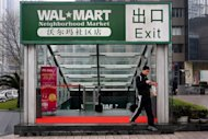 A man walks out of a Wal Mart outlet in Shenzhen. China said Tuesday it has approved a plan by Wal-Mart Stores Inc. to gain control of a local online supermarket, but imposed conditions on the deal over concerns it could hinder competition