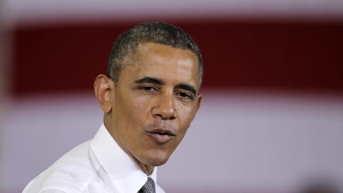 On jobs trip, Obama tries to leave problems behind