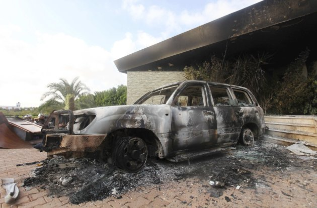 A burnt car is parked at the U.S. consulate, which was attacked and set on fire by gunmen yesterday, in Benghazi September 12, 2012. Christopher Stevens, the U.S. ambassador to Libya, and three embassy staff were killed as they rushed away from the consulate building, stormed by al Qaeda-linked gunmen blaming America for a film that they said insulted the Prophet Mohammad. Stevens was trying to leave the consulate building for a safer location as part of an evacuation when gunmen launched an intense attack, apparently forcing security personnel to withdraw. REUTERS/Esam Al-Fetori (LIBYA - Tags: POLITICS CIVIL UNREST)