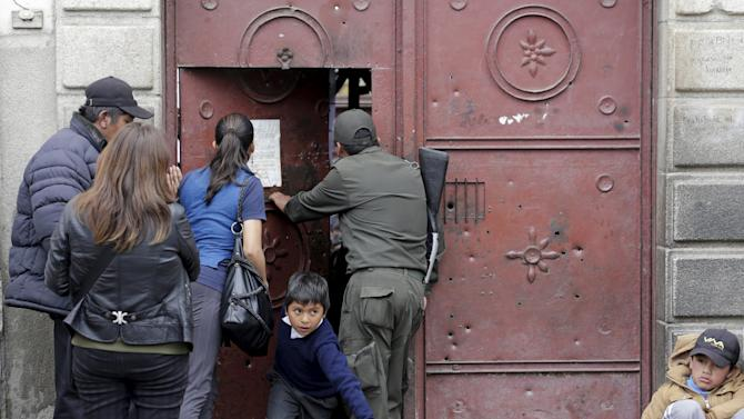 Relatives of inmates try to get information at the San Pedro prison during the prison's visiting day in La Paz