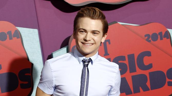 "FILE - This June 4, 2014 file photo shows Hunter Hayes at the CMT Music Awards at Bridgestone Arena in Nashville, Tenn. Hayes is set to join MTKO, the Vamps and other acts at the U.S. Open's annual Arthur Ashe Kids' Day. The ""Wanted"" singer said in a statement Wednesday that he's honored to be part of the Aug. 23 event at the Billie Jean King National Tennis Center in Queens, New York, where the last Grand Slam of the year is held in tennis. (Photo by Wade Payne/Invision/AP, File)"