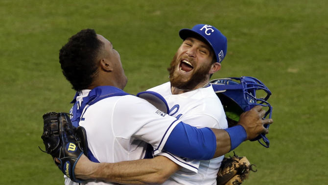 FILE - In this Wednesday, Oct. 15, 2014, file photo Kansas City Royals relief pitcher Greg Holland and catcher Salvador Perez celebrate after defeating the Baltimore Orioles 2-1 in Game 4 of the American League baseball championship series in Kansas City, Mo. The Royals grinded out runs one at a time. They stole bases, went first to third on infield hits, scrapped for the lead. Once they got it, they turned it over to Kelvin Herrera, Wade Davis and Greg Holland, a trio of relievers whose 100 mph fastballs were nearly unhittable.  (AP Photo/Chris O'Meara, File)
