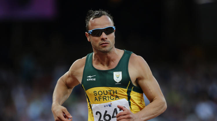 FILE - In this Sept. 5, 2012 file photo, South Africa's Oscar Pistorius competes during Men's 100m T44 round 1 at the 2012 Paralympics in London. A judge in South Africa says Pistorius, who is charged with murdering his girlfriend, can leave South Africa to compete in international competition, with conditions. (AP Photo/Emilio Morenatti, File)