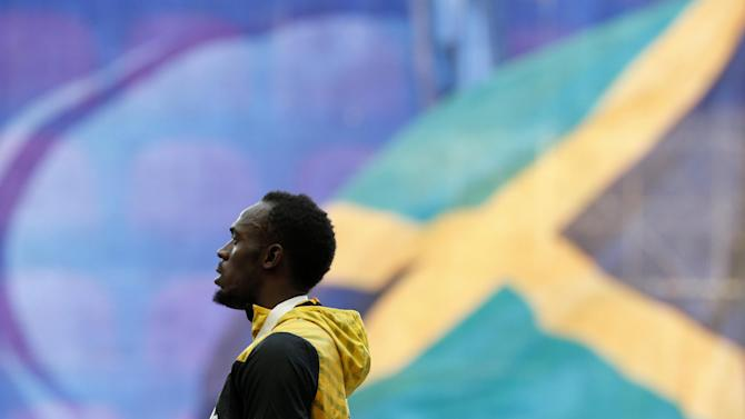 Jamaica's Usain Bolt listens to the national anthem during the medal ceremony for the men's 200 meters at the World Athletics Championships in the Luzhniki stadium in Moscow, Russia, Sunday, Aug. 18, 2013. (AP Photo/Alexander Zemlianichenko)