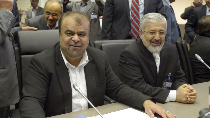 Iran's Minister of Petroleum Rostam Ghasemi, left, and Iran's Ambassador to the International Atomic Energy Agency, IAEA, Ali Asghar Soltanieh listen to journalists prior to the start of a meeting of the Organization of the Petroleum Exporting Countries, OPEC, at their headquarters in Vienna, Austria, Friday, May. 31, 2013. (AP Photo/Hans Punz)