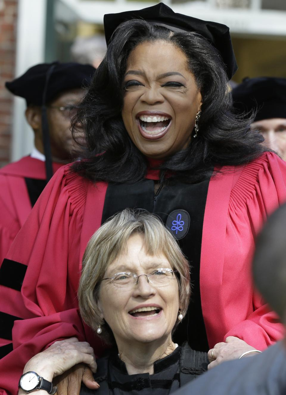 Oprah Winfrey laughs with Harvard University President Drew Faust prior to receiving an honorary degree from Harvard during commencement ceremonies in Cambridge, Mass., Thursday, May 30, 2013. (AP Photo/Elise Amendola)
