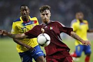 Venezuela's Fernando Amorebieta (R) fight for the ball with Ecuador's Jaime Ayovi during their 2014 World Cup qualifying soccer match in Puerto La Cruz, October 16, 2012. REUTERS/Jorge Silva