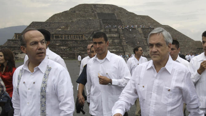 Chile's President Sebastian Pinera, right, walks with Mexico's President Felipe Calderon, left, at the Teotihuacan archeological site on the outskirts of Mexico City, Saturday July 9, 2011. Pinera is on a three-day official visit to Mexico. (AP Photo/Franklin Reyes)