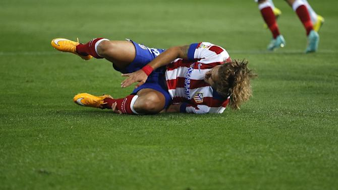 Atletico's Cerci gestures during a Spanish La Liga soccer match between Celta and Atletico Madrid at the Vicente Calderon stadium in Madrid, Spain, Saturday, Sept. 20, 2014